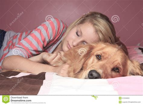 dogs sleeping in bedroom girl and her dog sleeping together on a bedroom stock photo image 51234653