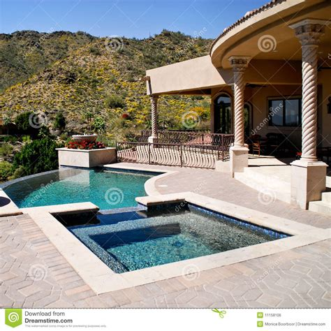 Pools Patios And Spas backyard patio with pool and spa royalty free stock image