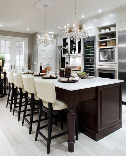 kitchen island chandeliers white quartz countertops dark wood white cabinets