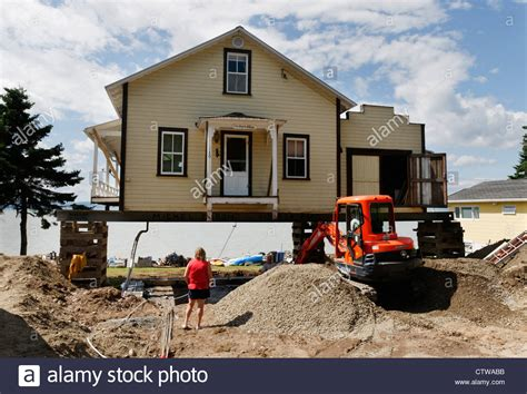 can i buy a house in canada a house in canada jacked up on stilts so that the owner can have the stock photo