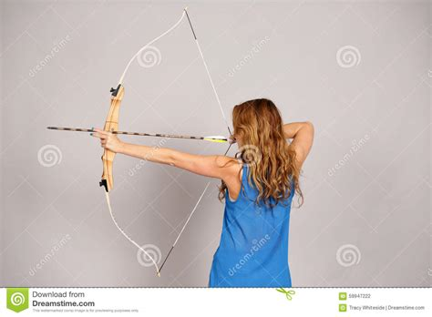 bow in her hair and rear view back view of girl with bow and arrow stock photo image