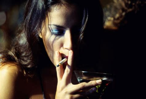 Woman smoking and drinking