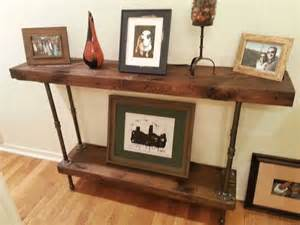 console table built out of reclaimed lumber and black