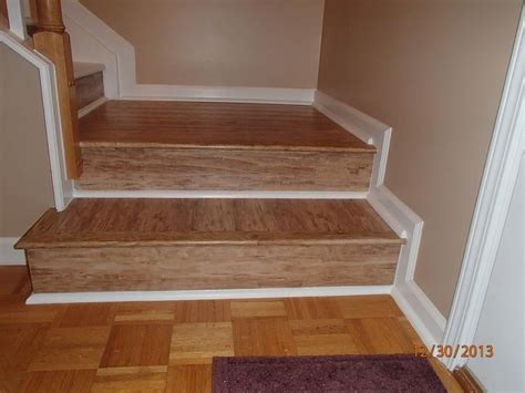 laminate stair case with white quarter round accents and an overlap stairnose yelp
