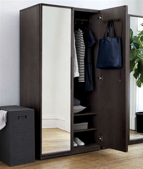 cb2 armoire how to display your capsule wardrobe
