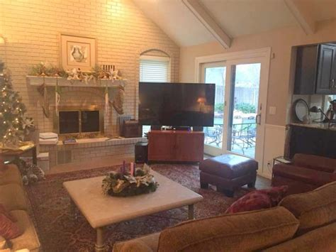 putting a tv a fireplace ask the decorologist where to put the tv the decorologist