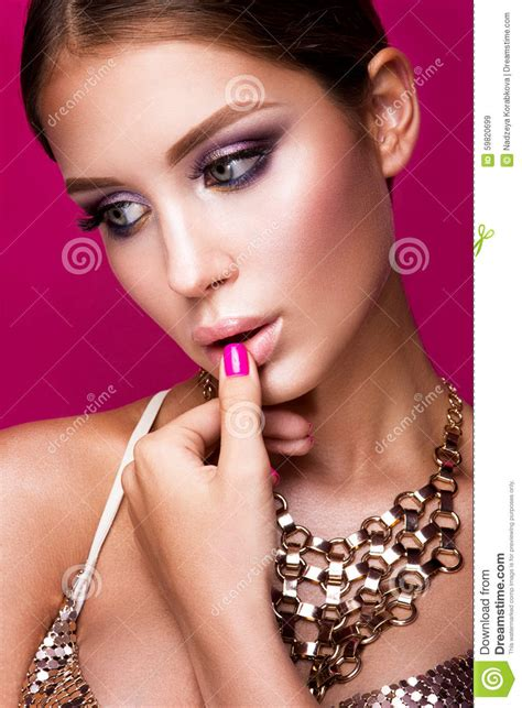 beautiful fashion model in jewelery and lila manicure beauty fashion model girl with bright makeup long stock