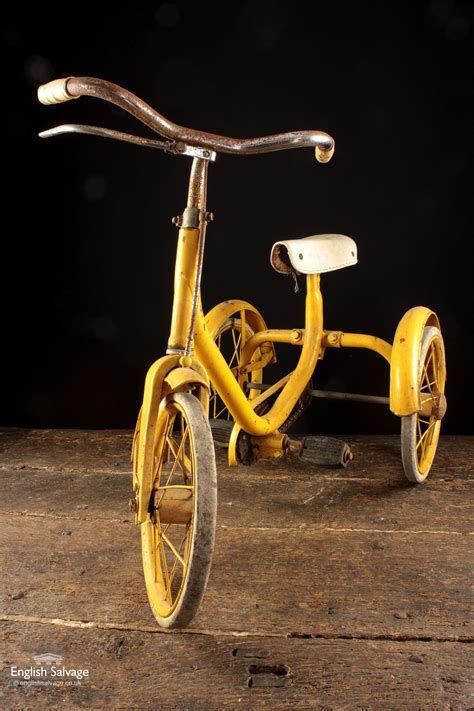 vintage yellow tricycle