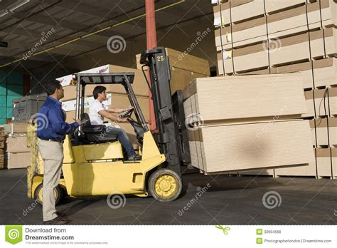 warehouseman and forklift truck driver in timber factory royalty free stock photos image 33904568