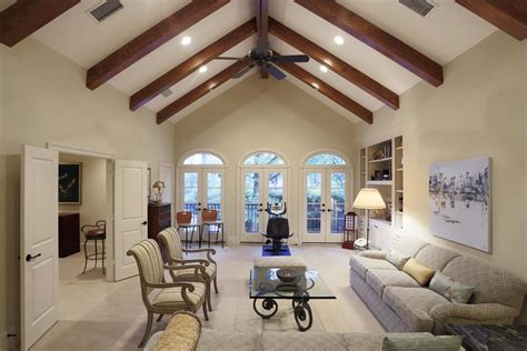 cathedral ceiling beams exposed brick fireplace living room tv wall design living room design with high ceilings
