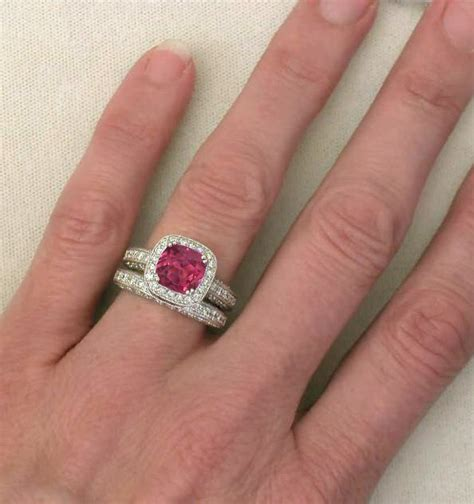 cushion cut pink tourmaline and engagement ring and wedding band with milgrain edging