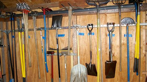 Garden Tool Wall Rack 15 Neat Garage Organization Ideas Hirerush