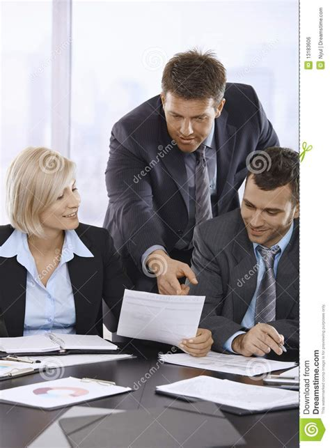 business people reviewing documents royalty  stock