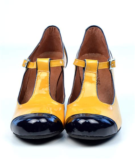 the dusty in yellow black patent leather retro