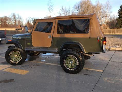 jeep scrambler lifted jeep cj 8 scrambler green lifted top back seat