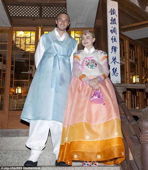 Pink Casual Hanbok moretz wears traditional korean dress during seoul