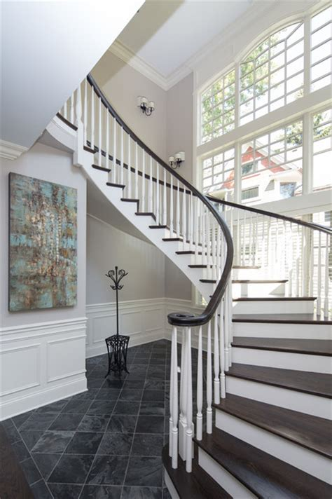 Custom Staircase Design Custom Built Curving Two Tone Wood Staircase Traditional Staircase Chicago By Miller