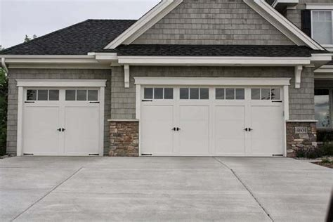 residential white carriage garage doors  top windows