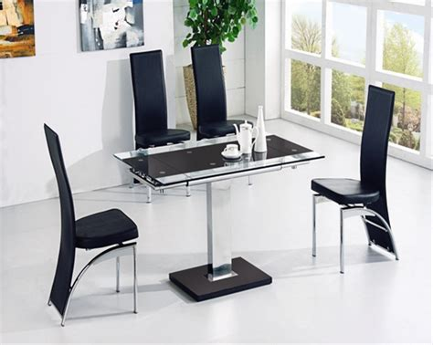 modern small extending glass dining table and 4 chairs in