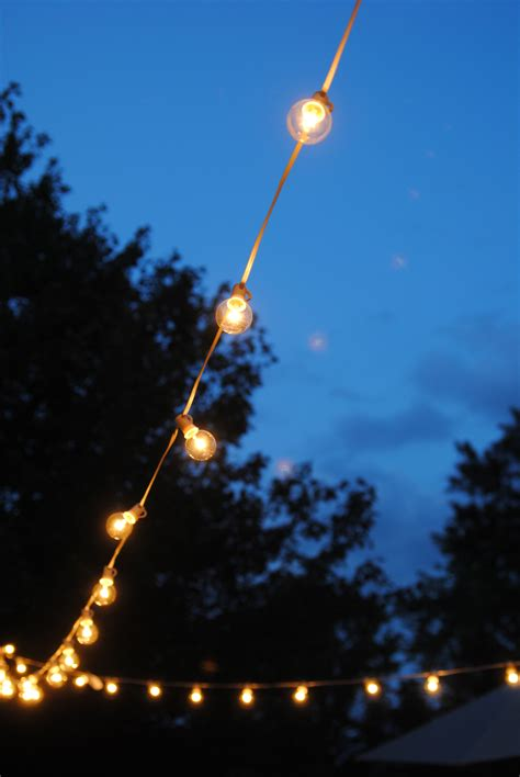 Outdoor Patio Hanging String Lights How To Hang Outdoor String Lights The Deck Diaries Part 3 Lemonade