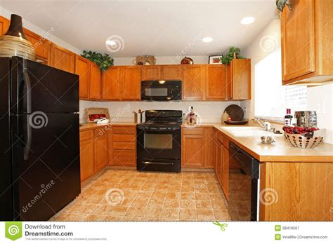 discount cabinets and appliances brown kitchen cabinets with black appliances royalty free