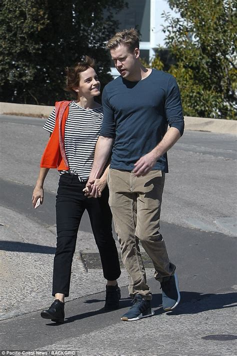 latest uk and world news sport and comment daily express emma watson holds hands with glee s chord overstreet