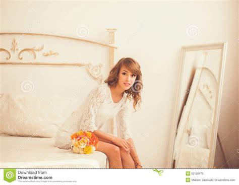 girl sitting on bed girl sitting on the bed stock photo image 52128470