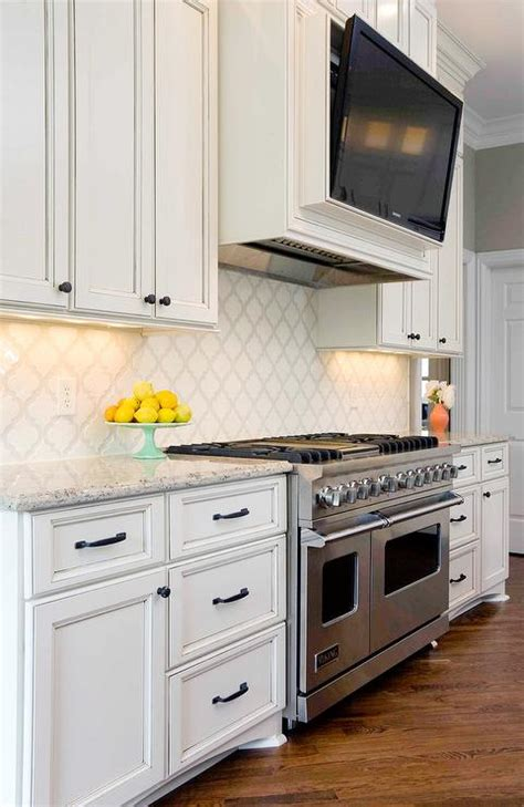 tv for kitchen cabinet white kitchen cabinets with black and gray granite