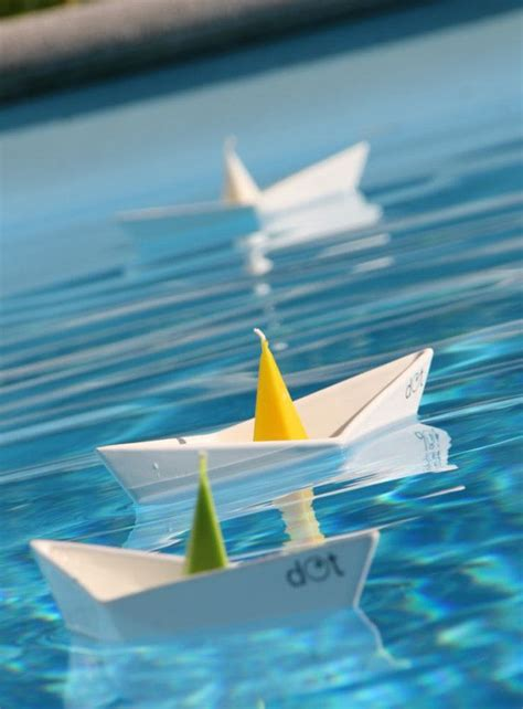 origami boat party on the floating showroom floating boat candleholders by dot