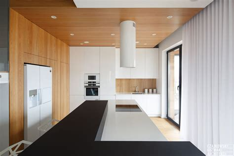 house design with white color poland modern home interior black white light wood color scheme 2