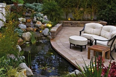 Home Depot Decorative Shelves backyard pond and patio with a rock waterfall