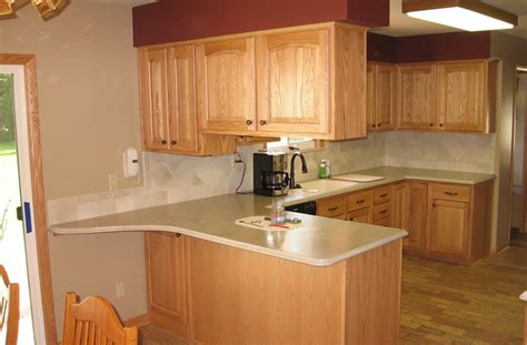 kitchen cabinet remodeling should you do it evan spirk should you tile under kitchen cabinets should you tile