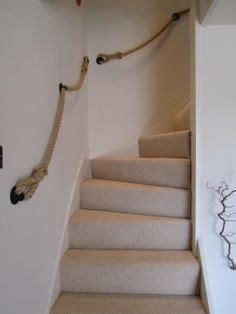 rope banister rope staircase railing bannister wrapped around steel bards do it yourself