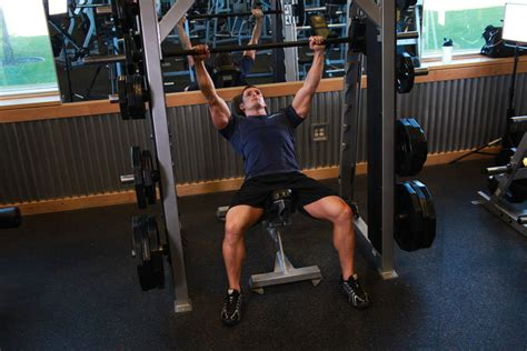 bench press with smith machine smith machine incline bench press exercise guide and video