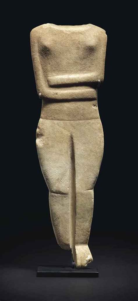 reclining female figure a large cycladic marble reclining female figure