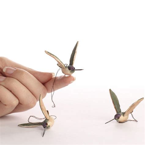 small artificial mushroom hummingbirds birds