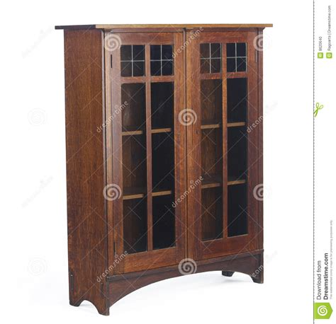 arts and crafts glass doored bookcase editorial image