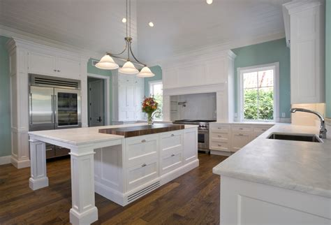 light mint blue paint adds burst of color to this all white kitchen hardwood