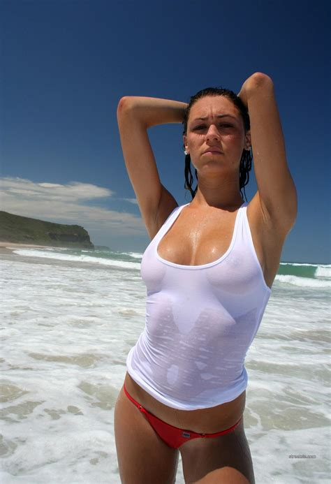 wet shirt babe in the surf surfing vingle very community