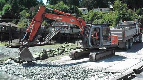 boat launch vancouver island hitachi excavator works on boat launch at low tide