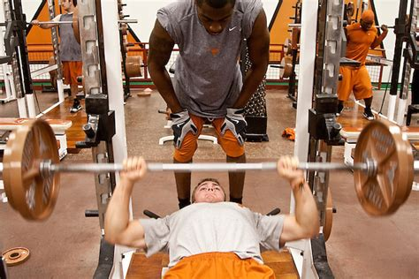 weight room workouts for football players longhorns weight darren carroll photography