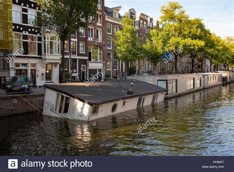 sinking canal boat stock photos sinking canal boat stock - Sinking Houseboat Amsterdam