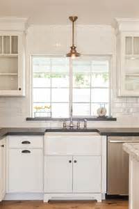 Farmhouse Sink With Overhead Pendant Light By Bathroom Cabinet Designkitchen Window Designs
