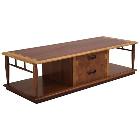 acclaim large coffee table in walnut and oak with