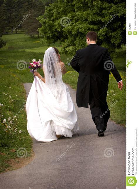 bride  groom walking  stock photo image