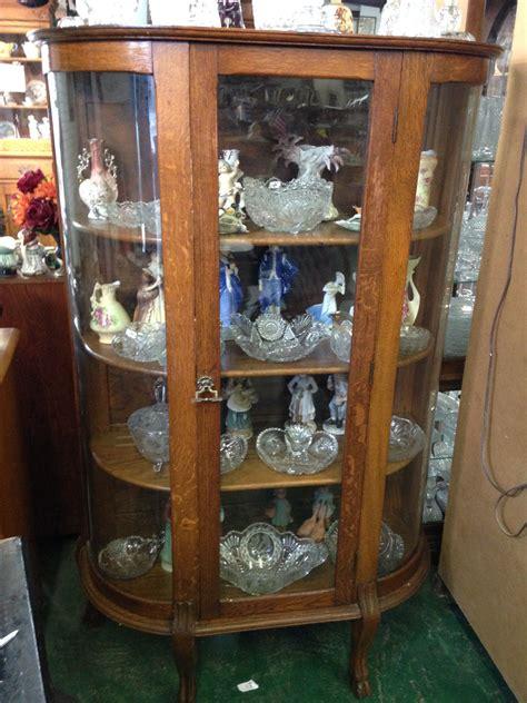 antique oak glass front curio cabinet wood shelves