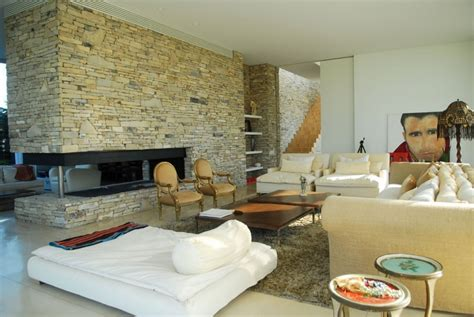 how to open fireplace der open plan living featuring wall and fireplace