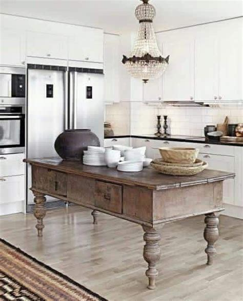 antique island for kitchen this antique island in the kitchen adds a unique rustic farmhouse charm to the space