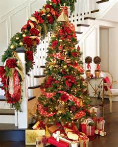 red floral christmas tree with stairs decoration
