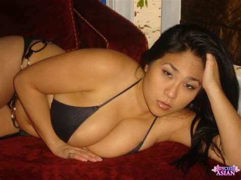 black couch porn buxom asian brunette posing differently on red couch in